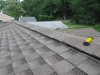 Inspecting a roof for structural concerns.